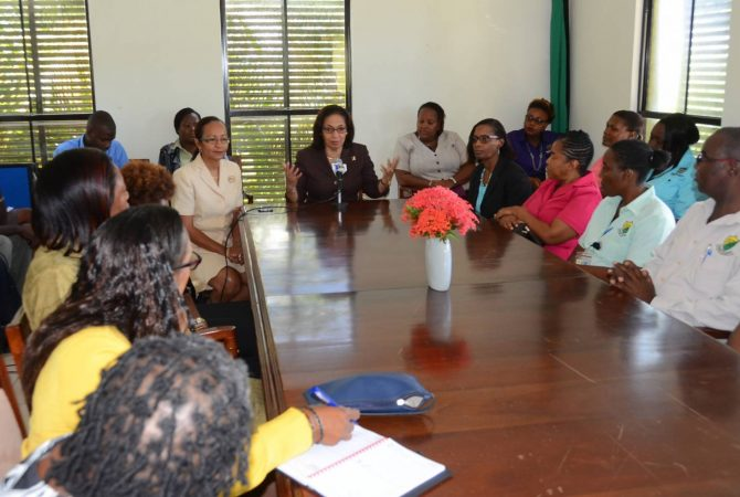 Labour and Social Security Minister, Hon. Shahine Robinson (centre), emphasizes a point while addressing managers and staff at the Ministry's St. Mary parish office in Port Maria on June 23. Occasion was a familiarization visit by Mrs. Robinson.