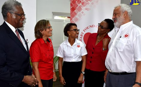Heart Foundation Board member, Maurice Anderson (left); Executive Director of the Foundation, Deborah Chen (second left); Consultant Cardiologist and Chair of the Foundation, Dr. Andrene Chung (third left) and Sports Medicine Specialist, Dr. Paul Wright (right), in conversation with Acting Director of Health Promotion and Protection in the Ministry of Health, Dr. Beverley Wright (second right), during the media launch for Heart Month (February) on January 24 at the Spanish Court Hotel in Kingston.