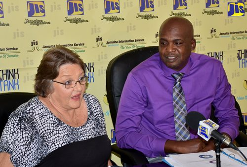 Manager for Crime Stop Jamaica, Prudence Gentles (left) speaking at a JIS Think Tank held recently. At right is Director of Licensing and Registration and Acting Director of Enforcement, at the Betting, Gaming and Lotteries Commission (BGLC), Maurice Thompson.