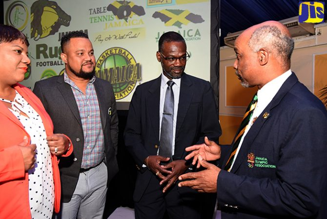 Permanent Secretary in the Ministry of Culture, Gender, Entertainment and Sport, Denzil Thorpe (second right), listens to a point from President of the Jamaica Olympic Association (JOA), Christopher Samuda (right), during a press briefing at the Terra Nova All-Suite Hotel in St. Andrew on Thursday (February 22), to provide details about the Jamaica Commonwealth Manor. Others (from left) are JOA Honorary Treasurer, Nichole Case; and Chief Executive Officer (CEO), Ryan Fraser. The Manor will be the official hospitality house of the Jamaican delegation at the 2018 Commonwealth Games in Gold Coast, Australia, from April 3 to 13.
