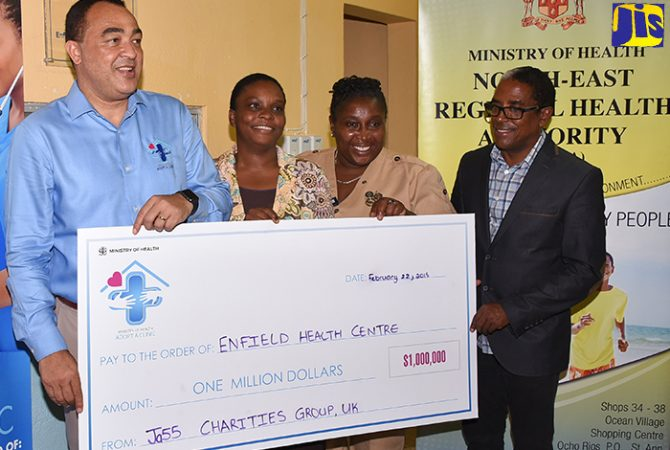 Health Minister, Dr. the Hon. Christopher Tufton (left), displays a symbolic cheque in the sum of $1 million presented to the Enfield Health Centre in St. Mary under the Government's Adopt-a-Clinic initiative. Others (from second left) are: Acting Parish Manager, St. Mary Health Services, Sherrie Ellis-Wallace; Senior Public Health Nurse for St. Mary, Dawn-Marie Betton-Richards; and Member of Parliament for South East St. Mary, where the clinic is located, Dr. Norman Dunn. The Adopt-a-Clinic initiative, launched last year by the Jamaica 55 Charities Group United Kingdom (UK), aims to mobilise Jamaicans at home and in the diaspora to provide support, whether in cash or kind, for the country's primary-healthcare facilities.