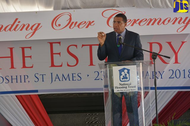 Prime Minister the Most Hon. Andrew Holness delivering the keynote address at a ceremony to hand over keys for units at The Estuary, Friendship, St. James on February 23.