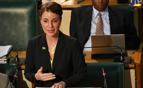 Minister of Foreign Affairs and Foreign Trade, and Leader of Government Business in the Upper House, Senator the Hon. Kamina Johnson Smith, pilots the Trafficking in Persons (Prevention, Suppression and Punishment) (Amendment) Act, 2018; and companion Bill, the Child Care and Protection (Amendment) Act, 2018, in the Senate on Friday (February 23). Also pictured in the background, is Deputy President of the Senate, Senator Aubyn Hill.