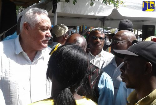 Minister of Transport and Mining, Hon. Lester 'Mike' Henry interacts with operators of public passenger vehicles (PPV) following the announcement that the Montego Bay Transport centre on Barnett Street in St. James will be renovated. The announcement was made at a media briefing held on Friday, February 23, at the Transport Centre.