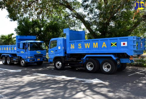 The two new tipper trucks, valued at $21 million, which were handed over to the National Solid Waste Management Authority (NSWMA) by the Government of Japan. The presentation was made during the closing ceremony for a cooperation pilot project on solid waste reduction between the NSWMA and the Japan International Co-operation Agency (JICA), at the Courtleigh Hotel and Suites in New Kingston on January 27. The trucks will be used for garbage collection in the Kingston Metropolitan Area (KMA).