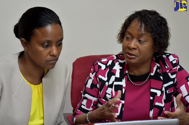 Early Childhood Commission (ECC) Chairperson, Trisha Williams-Singh (left), being updated on sector developments by Acting Executive Director, Karlene Degrasse-Deslandes.
