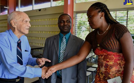 Education Officer in the Ministry of Education, Youth and Information, Lebert Drysdale (centre) looks on as recipient of the Distinguished Old Farmer of Excellence for 2017, John R. Gayle (left) greets Old Farmers' Association of North America (OFANA) scholarship awardee, Moya Campbell during a founders' day ceremony at the College of Agriculture, Science and Education (CASE), campus located at Passley Gardens, Portland on January 28.