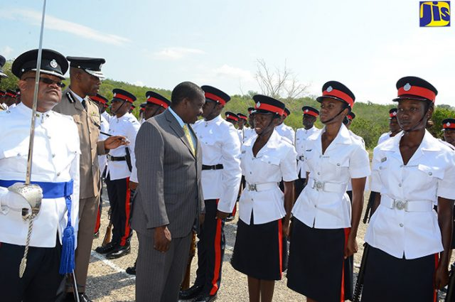 National Security Minister, Hon. Robert Montague (centre), reviews Jamaica Constabulary Force (JCF) recruits who were on parade during their Passing Out and Awards Ceremony at the National Police College of Jamaica (NPCJ), in Twickenham Park, St. Catherine last year.