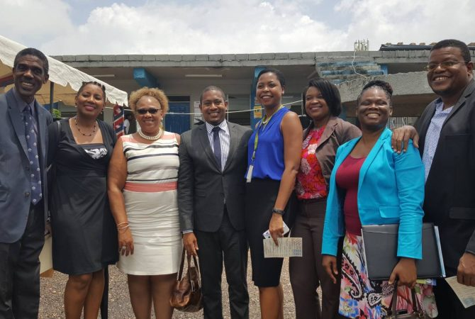 State Minister in the Ministry of Education, Youth and Information, Hon. Floyd Green (fourth left), with Olivia Leigh Campbell, of Sutherland Global, and senior members of staff of Community Colleges, at the Career and Information Fair, held at Knox Community College's Mandeville Campus in Manchester, on April 26.