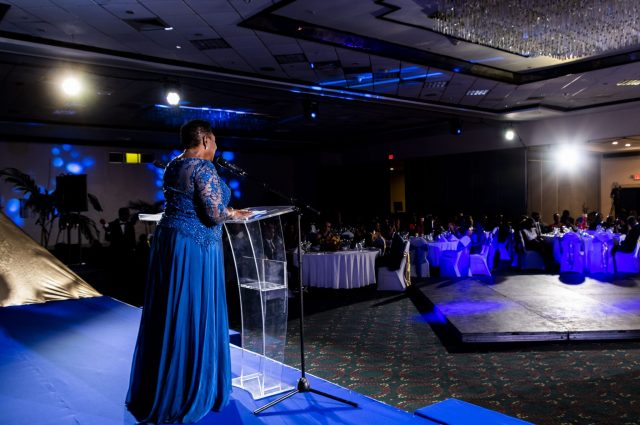 Minister of Culture, Gender, Entertainment and Sport, the Honourable Olivia Grange addresses the Women's Centre of Jamaica Foundation's 40th Anniversary Charity Ball. At the event, Minister Grange launched A-STREAM (Advancing Secondary, Tertiary, Remedial Education for Adolescent Mothers) a programme designed for teenaged mothers who are at risk of dropping out of school.