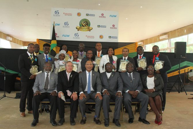 Governor General, His Excellency the Most Hon. Sir Patrick Allen (seated third from left), with the 13 recipients of the 2018 Governor General's Achievement Awards (GGAA) for the County of Cornwall. The award ceremony was held at the Melia Braco Village in Trelwany on May 25. Also sharing the moment (seated from left) are Custos of Hanover, Dr. David Stair; Custos of Trelawny, Paul Muchette; Custos of Wetmoreland, Rev. Hartley Perrin; Custos of St. James, Bishop Conrad Pitkin; and Custos of St. Elizabeth, Beryl Rochester.