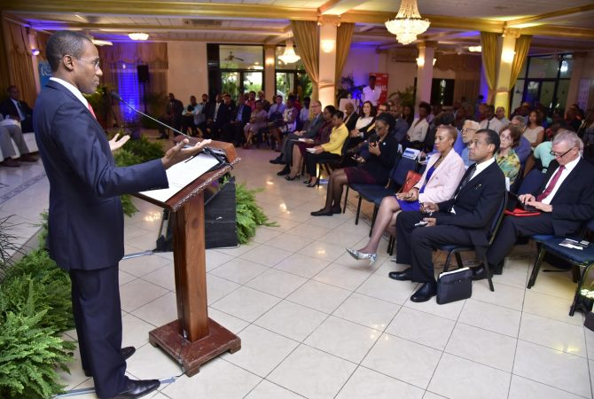 Finance and the Public Service Minister, Dr. the Hon. Nigel Clarke (left), emphasises a point while speaking at the Caribbean Policy Research Institute's public forum on the proposed establishment of Jamaica's independent Fiscal Council. The forum was held at the Mona Visitors' Lodge, University of the West Indies, Mona, St. Andrew, on Thursday (June 14). Among those attending were Minister without Portfolio in the Ministry of Finance and the Public Service, Hon. Fayval Williams (second right); and Senior Policy Advisor in the Ministry, Gerrard Johnson (right).