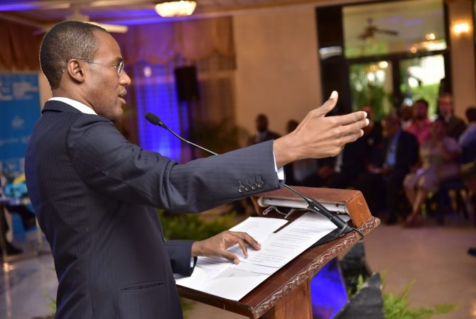 Finance and the Public Service Minister, Dr. the Hon. Nigel Clarke, addresses the Caribbean Policy Research Institute's (CAPRI) public forum on the Independent Fiscal Council, at the Mona Visitors' Lodge, University of the West Indies (UWI), Mona Campus, St. Andrew, on Thursday (June 14).