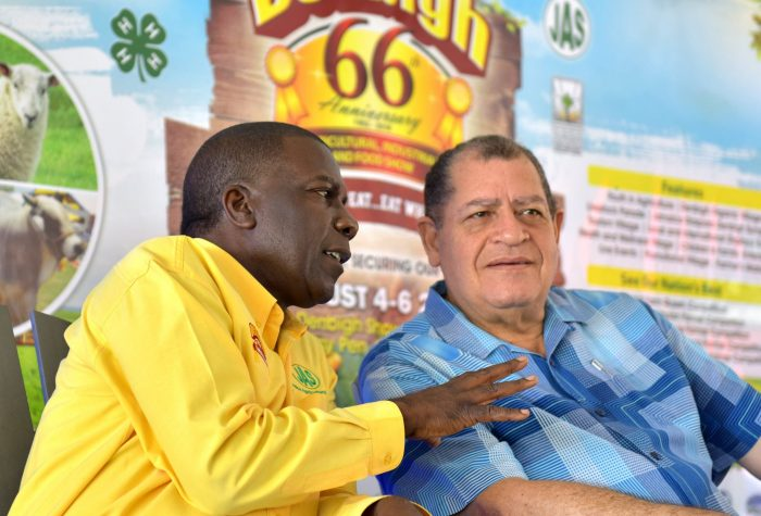 Industry, Commerce, Agriculture and Fisheries Minister, Hon. Audley Shaw ( right), listens to a point being made by Jamaica Agricultural Society (JAS) President, Norman Grant, at the launch of the 66th staging of the Denbigh Agricultural, Industrial and Food Show, at the Hi-Pro Supercentre in White Marl, St. Catherine on June 15.