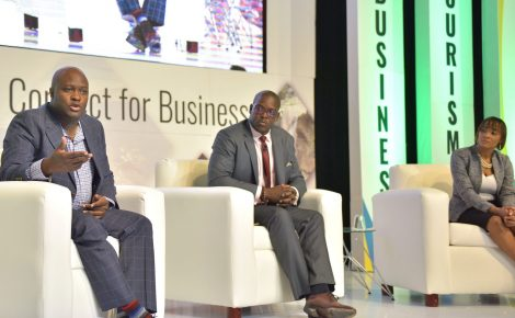 Chief Executive Officer at eGov Jamaica Limited, Maurice Barnes (left), addresses a plenary session at the just-concluded Jamaica Investment Forum (JIF) 2018, held at the Montego Bay Convention Centre in St. James. Listening keenly (from second left) are Managing Director, Flow Jamaica, Stephen Price; and Director of Information Technology, Jamaica Public Service Company Limited, Donnelle Watson-Banks.