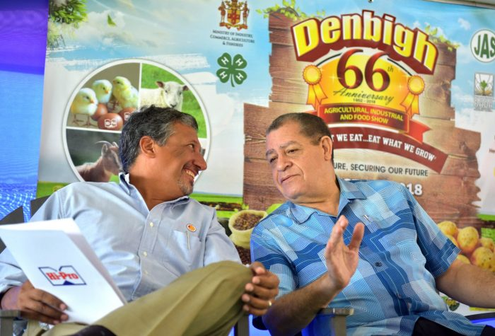 Industry, Commerce, Agriculture and Fisheries Minister, Hon. Audley Shaw (right), converses with Chief Executive Officer (CEO), Jamaica Broilers Group, Christopher Levy, at the launch of the 66th staging of the Denbigh Agricultural, Industrial and Food Show, at the Hi-Pro Supercentre in White Marl, St. Catherine on June 15.