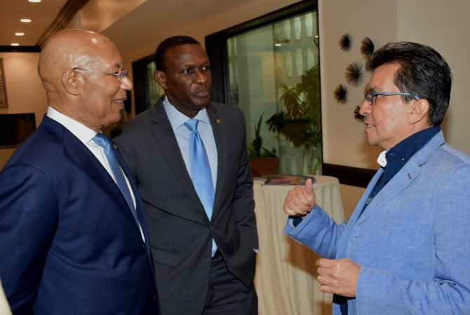 Governor- General, His Excellency the Most Hon. Sir Patrick Allen (left) and Chief Executive Officer of the FosRich Group of Companies, Cecil Foster (centre), listen to a point being made by Specialist in Electrical Distribution Systems at Nexans, Edgar Jaimes. Occasion was the opening of FosRich Electrical Expo 2018 at The Jamaica Pegasus hotel in New Kingston on June 14. The one-day expo involved partnership with Nexans, a global leader in advanced cabling and connectivity solutions, and renowned global producer of energy-efficient technologies, Siemens.