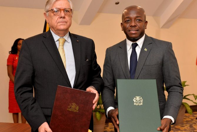 State Minister for Foreign Affairs and Foreign Trade, Senator the Hon. Pearnel Charles Jr. (right), and Under Secretary of Foreign Affairs, Chile, Alfonso Silva Navarro, display signed copies of a Declaration of Intent for Jamaica and Chile to exchange expertise in sports. The signing took place at the Jewel Grande Montego Bay Resort and Spa in St. James on Saturday (July 8), following bilateral talks between Prime Minister, the Most Hon. Andrew Holness, and President of the Republic of Chile, His Excellency Sebastián Piñera. President Piñera was a special guest at the 39th Regular Meeting of the Conference of Heads of Government of CARICOM, which took place at the Montego Bay Convention Centre in St. James from July 4-6.