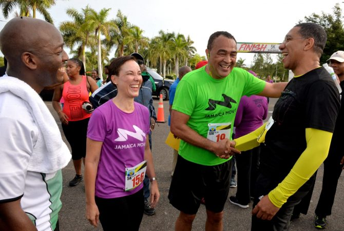 Prime Minister, the Most Hon. Andrew Holness ( right) and Minister of Health, Dr. the Hon. Christopher Tufton (2nd right), exchange a congratulatory handshake after completing the CARICOM road race held on Saturday (July 7) in Montego Bay. Sharing the moment are Minister of Foreign Affairs and Foreign Trade, Senator the Hon. Kamina Johnson Smith (2nd left); and State Minister in the Ministry, Senator the Hon. Pearnel Charles Jr., who also participated in the event. The race followed the 39th Regular Meeting of the Conference of Heads of Government of CARICOM, which took place at the Montego Bay Convention Centre in St. James from July 4-6.