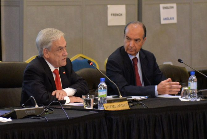 President of the Republic of Chile, His Excellency Sebastián Piñera (left), addresses the third plenary session at the 39th Regular Meeting of the Conference of Heads of Government of CARICOM on Friday (July 6), at the Montego Bay Convention Centre in St. James. Also pictured is Chilean Ambassador to Jamaica, His Excellency Eduardo Bonilla.