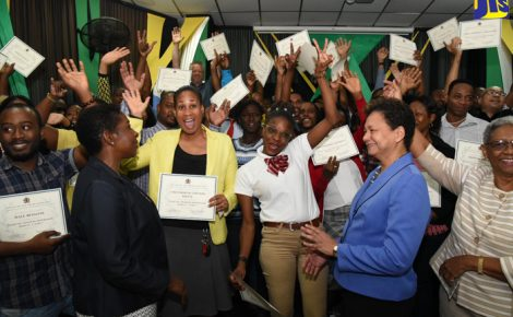 Principal Finance Officer at the Office of the Prime Minister (OPM), Rosalie Phipps (2nd right), along with Co-Task Team Leader at the World Bank, Karlene Francis (2nd left), and Project Manager for the OPM Youth Employment in the Digital and Animation Industries (YEDAI) Project, Margery Newland (right), celebrate with animation instructors at the closing ceremony for YEDAI's 'Train the Trainers' course held on (July 27) at the Excelsior Community College in Kingston. Fifty animation instructors participated in the training.