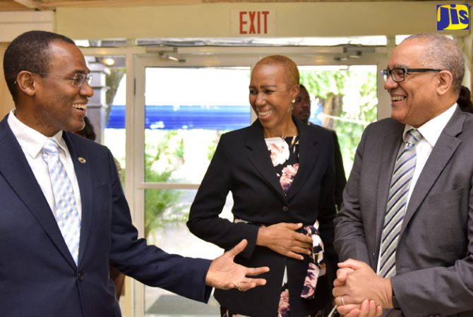 Finance and the Public Service Minister, Dr. the Hon. Nigel Clarke (left), shares a joke with Minister without Portfolio in the Ministry of Finance and the Public Service, Hon. Fayval Williams (centre); and Bank of Jamaica (BOJ) Governor, Brian Wynter, prior to the start of the second annual National Financial Inclusion Council Meeting and Forum, at the Terra Nova All-Suite Hotel in St. Andrew on Friday (July 27). Dr. Clarke chairs the Council, while Mr. Wynter is Chairman of the Financial Inclusion Steering Committee.