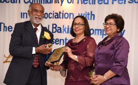 Minister of Labour and Social Security, Hon. Shahine Robinson (centre) presents a plaque to Dr. Owen James (left) at the Caribbean Community of Retired Persons' (CCRP) Living Legacy Awards ceremony held on Friday (September 28) at the Mona Visitors Lodge, University of the West Indies (UWI), Mona Campus. Sharing the moment is founder and executive chairperson of CCRP, Jean Lowrie- Chin. The annual CCRP Living Legacy Awards recognise senior citizens, 55 years or older, who have contributed to the growth and development of the country.