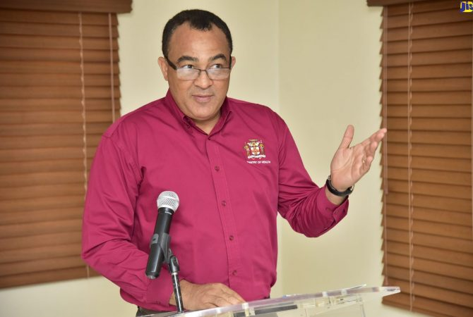 Minister of Health, Dr. the Hon. Christopher Tufton, addresses a recent meeting with nutritionists and dieticians from hospitals and health departments across the island, at the Spanish Court Hotel in New Kingston.