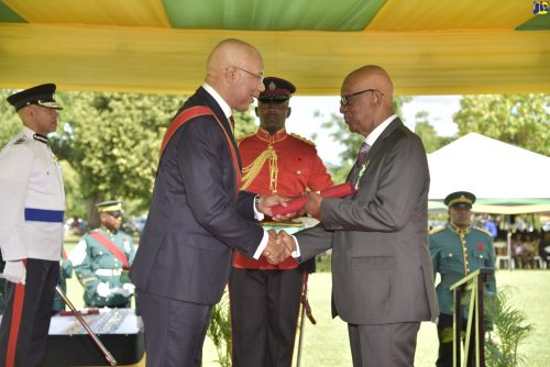Governor General, His Excellency the Most Hon. Sir Patrick Allen (left), presents former chief financial officer of the West Indies Union Conference of Seventh-day Adventists, Pastor Aston Barnes, with the Order of Distinction - Officer Class (OD), for invaluable contribution to the ministerial fraternity, social development, welfare and philanthropy, at the 2018 National Honours and Awards ceremony held at King's House on National Heroes Day, Monday, October 15.