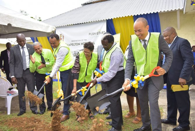 Minister of Health, Dr. the Hon. Christopher Tufton (third left); and Head of the Push Start Foundation, Beverly Nichols (fourth left), participate in the breaking of ground for the US$-million expansion and upgade of the Chapelton Community Hospital in Clarendon on Thursday (October 18). Others (from left) are: State Minister in the Ministry of Foreign Affairs and Foreign Trade, Hon. Pearnel Charles Jr.; Mayor of May Pen, Councillor Winston Maragh; Member of Parliament for North Central Clarendon, Hon. Pearnel Charles Sr.; and Chairman of the Southern Regional Health Authority (SRHA), Wayne Chen.