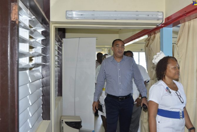 Minister of Health, Dr. the Hon. Christopher Tufton, tours the male ward at the Cornwall Regional Hospital, in St. James, on November 9. He also handed over 44 additional beds to the institution. With the Minister is Ward Manager at the hospital, Annet Malcolm.