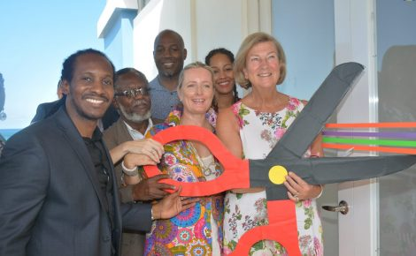 Minister of State in the Ministry of Culture, Gender, Entertainment and Sport, Hon. Alando Terrelonge (left), assists with the cutting of the ribbon to officially open the Sport and Community Centre, at Orchard, Hopewell, in Hanover, on November 9. Also participating in the exercise are (from second left): Custos of Hanover, Dr. the Hon. David Stair; Founder of the Lennox Lewis League of Champions Foundation, Lennox Lewis; Chairperson of Hanover Charities , Katrin Casserly ; Co-Founder of the Lennox Lewis League of Champions Foundation and wife of Lennox Lewis, Violet Lewis and shareholder at the Round Hill Hotel and Villas, Nan Brenninkmeyer.
