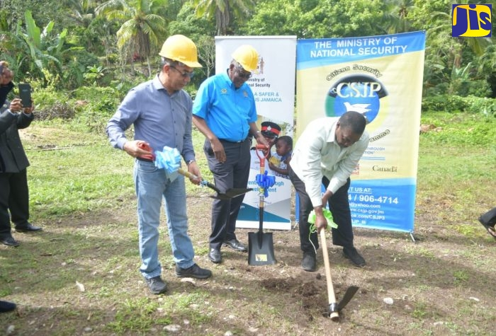 Minister of National Security, Hon. Dr. Horace Chang (left); Programme Manager for the Citizen Security and Justice Programme (CSJP), Simeon Robinson (centre); and Minister of Transport and Mining and Member of Parliament for Western St. Mary, Hon. Robert Montague, participate in the breaking of ground for phase one of the rehabilitation and expansion of the Gayle multi-purpose community centre in St. Mary on Thursday (December 13).
