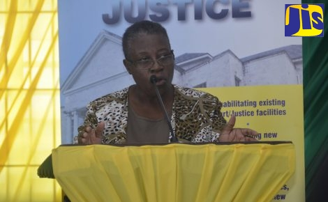 Senior Director for Corporate Services in the Ministry of Justice, Sandra Graham, addressing stakeholders during a recent Restorative Justice Youth Town Hall Meeting at Sam Sharpe Teachers' College in Granville, St. James.