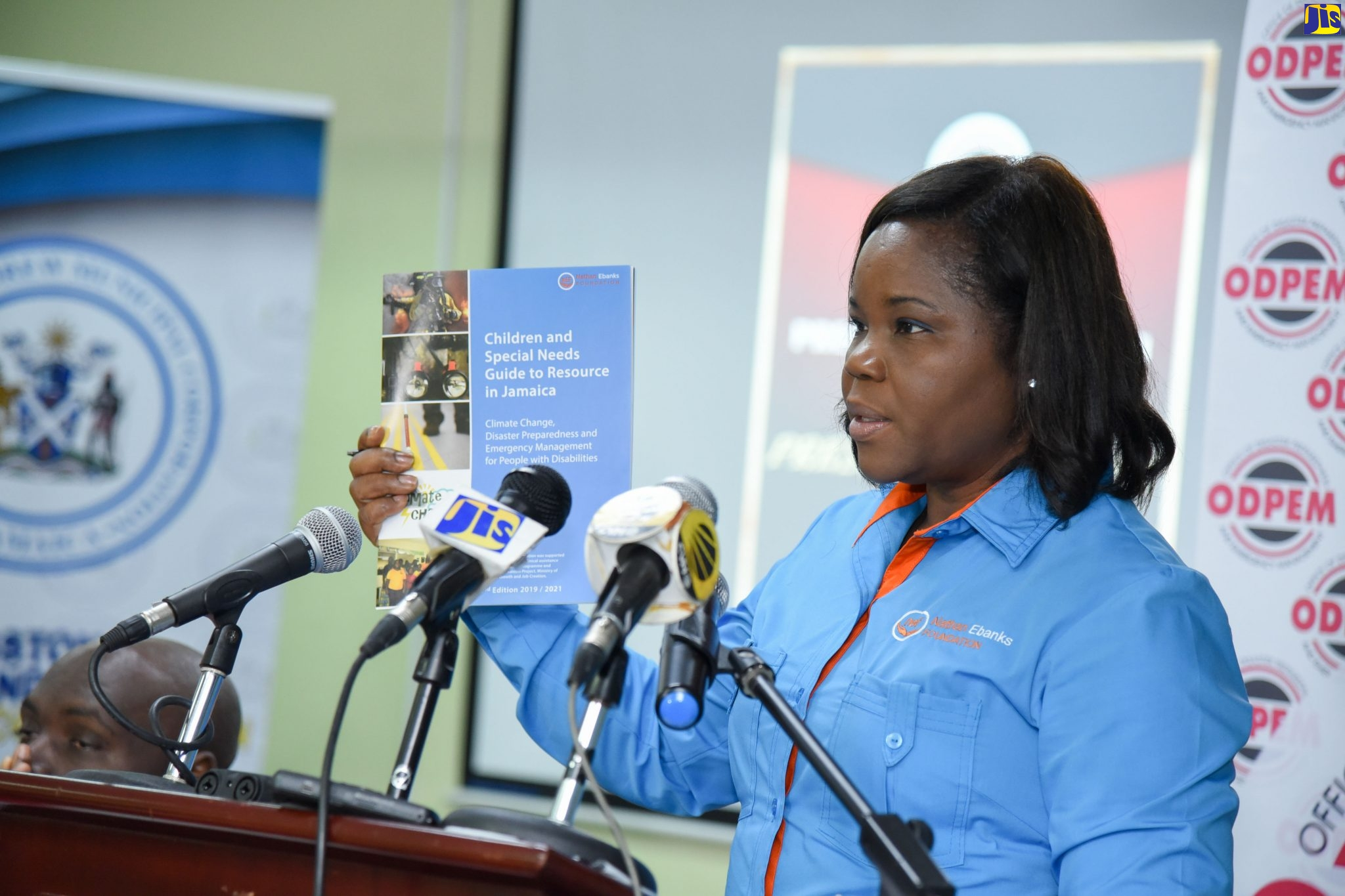 "President and Founder of the Nathan Ebanks Foundation (NEF), Christine Staple-Ebanks, displays a copy of the second edition of the organisation's publication – ""Children and Special Needs Guide to Resource in Jamaica' - during a recent forum at the Office of Disaster Preparedness and Emergency Management (ODPEM) in Kingston"