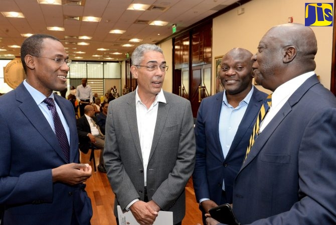 Finance and the Public Service Minister, Dr. the Hon. Nigel Clarke (left), engages in discussion with (from second left) incoming Bank of Jamaica (BOJ) Governor, Richard Byles; International Monetary Fund (IMF) Resident Representative for Jamaica, Dr. Constant Lonkeng Ngouana; and Senior Deputy Governor, John Robinson. Occasion was Wednesday's (July 24) Foreign Exchange Market Development Symposium at the BOJ Auditorium in downtown Kingston. The event was jointly staged by the Finance Ministry and the Central Bank.