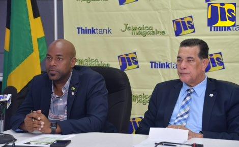 Mayor of Montego Bay, Councillor Homer Davis (right ) and Councillor Dwight Crawford, listen keenly to questions at a JIS 'Think Tank' at the St. James Municipal Corporation on July 25.