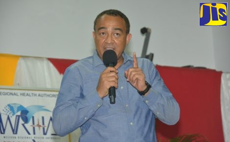 Minister of Health and Wellness, Dr. the Hon. Christopher Tufton, speaks at a Dengue Town Hall Meeting, held at the Negril Community Centre in Westmoreland on Thursday, December 12.