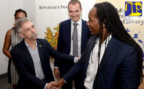 State Minister in the Ministry of Education, Youth and Information, Hon. Alando Terrelonge (right), is greeted by President of Alliance Francaise de la Jamaique,Pierre Lemaire, at the recent launch of the Integrate French as a Language of Exchange/Intégrer le Français comme Langue d'Échanges (IFLE) CARICOM Project in Jamaica, at the Embassy of France in St. Andrew. Others (from left) are Director of Alliance Francaise de la Jamaique, Marie-Noelle Brunot (partly hidden); and Charge d'Affires at the Embassy, Laurent Geslin.
