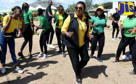 Minister of Culture, Gender, Entertainment and Sport, Hon. Olivia Grange (centre), joins in the recent Jamaica Day celebrations at the Denbigh High School in Clarendon.