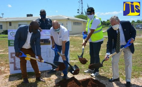 Minister of Health and Wellness, Dr. the Hon. Christopher Tufton (third left), breaks ground for the construction of a field hospital at the Falmouth Public General Hospital in Trelawny, on Friday, September 25. He is joined by (from left): Mayor of Falmouth, Councillor Colin Gager; Managing Director of Rogers Land Development Limited, Richard Rogers; and Custos Rotulorum for Trelawny, Paul Muschett. Observing is Director of the Western Regional Health Authority (WRHA), Errol Greene.