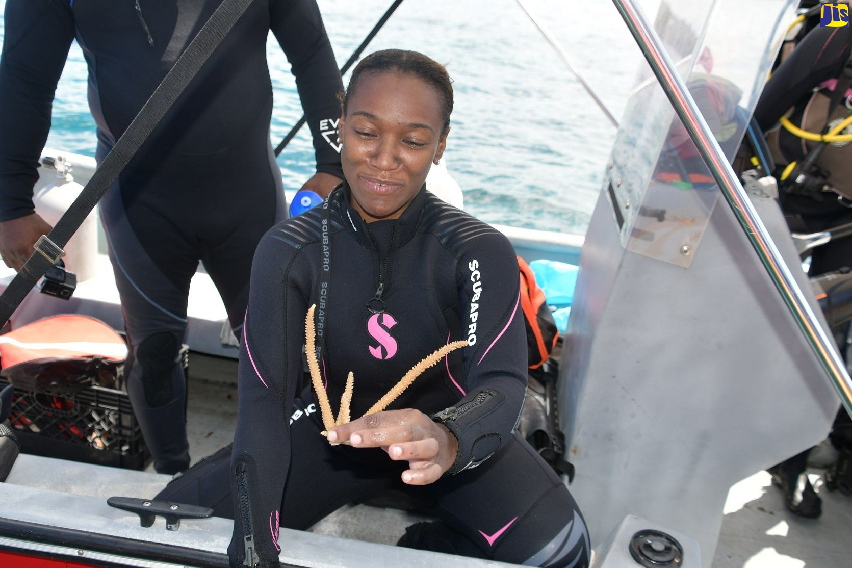 Project Manager, Integrating Water, Land and Ecosystems Management in Caribbean Small Island Developing States (IWEco) Jamaica, Loureene Jones displays coral pieces during a coral out-planting exercise at the Orange Bay Fish Sanctuary in Hanover on September 25.