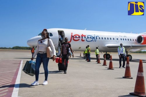 Passengers arrive on the inaugural Jet Air Caribbean flight from Curaçao International Airport to Norman Manley International Airport in Kingston, on Thursday, July 1.