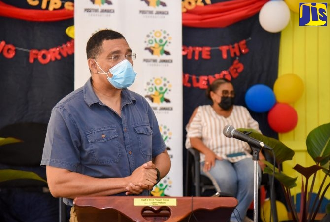 Prime Minister, the Most Hon. Andrew Holness, addresses a ceremony at the Clark's Town Primary School in Trelawny on Friday (July 2), to hand over 40 tablet computers to students under his Positive Jamaica Foundation. At right is Member of Parliament for Southern Trelawny, Marisa Dalrymple-Philibert.