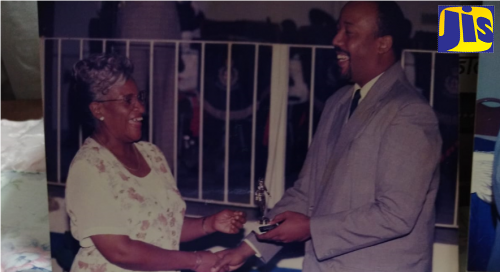 Former Deputy Matron of Kingston Public Hospital Lilian Bent-Miller (left), receives a trophy from a member of the Friends of Kingston Public Hospital in 1999 for long and dedicated service in the field of nursing.