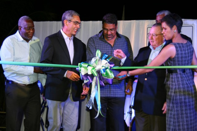 Minister of Tourism and Entertainment, Hon. Dr. Wykeham McNeill (centre); participates in the ribbon cutting exercise to officially declare the Jewel Paradise Cove Beach Resort and Spa open on December 7, with (from left): Senior Vice President, Investment and Chief Executive Officer (CEO) for Sagicor X Fund, Rohan Miller; President and CEO of Sagicor, Richard Byles; Senior VP Aimbridge Hospitality, Rich Cortese; General Manager Jewel Paradise Cove Beach Resort and Spa, Barbara Burton, and (partly hidden), Chairman of the Jamaica Tourist Board (JTB), John Lynch.