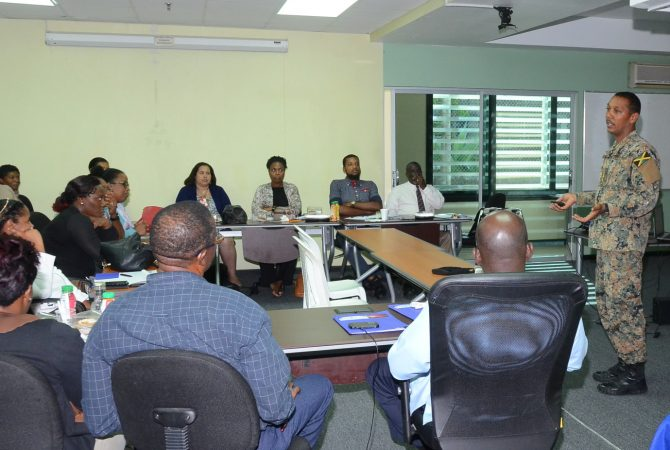 Lieutenant Colonel Mahatma Williams from the Jamaica Defence Force (right), addresses participants in the Disaster Risk Management and Emergency Operations Centre training course for the health sector, at the Office of Disaster Preparedness and Emergency Management , Haining Road, in Kingston.