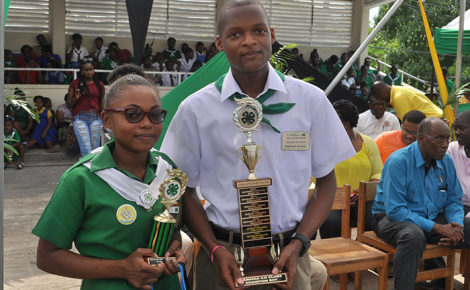 Jamaica 4-H Clubs' Girl of the Year, Shevone Smith (left) and Boy of the Year, Patrick Morris, display their trophies at the National Achievement Day Expo held recently, at the Denbigh Showground in May Pen, Clarendon.