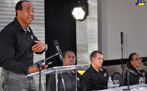 Economic Growth Council (EGC) Chairman, Michael Lee-Chin (left), addresses Thursday's (January 26) quarterly media briefing at The Jamaica Pegasus hotel in New Kingston. Seated (from left) are EGC Deputy Chairman, Ambassador Nigel Clarke; and members, Adam Stewart and Pat Ramsay.