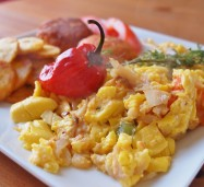 Traditional Jamaican Sunday morning breakfast - Ackee and Saltfish with Scotch Bonnet pepper